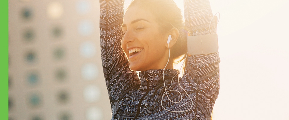 Power up for summer - playlist, woman stretching outdoors sun