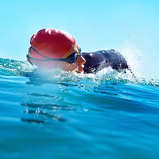 Holmes Place | Person Swimming in the Ocean