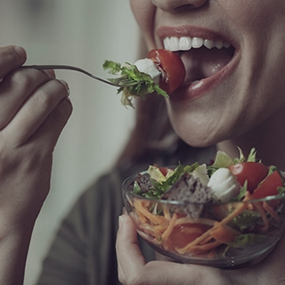 Holmes Place | Woman eating salad