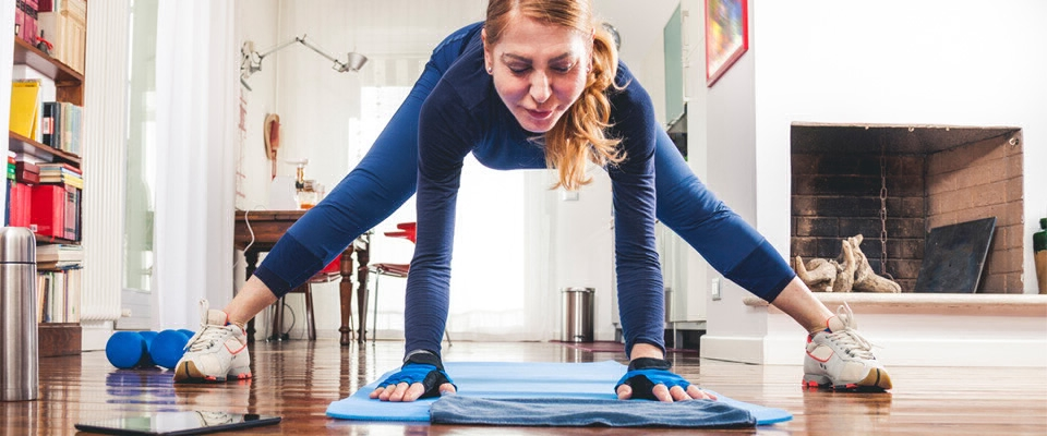 Holmes Place | woman indoor yoga mat floor exercise