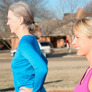Holmes Place | Women Exercising Outdoors
