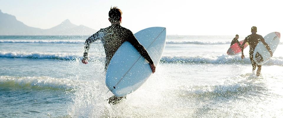 Surfing beach friends ocean | Holmes Place