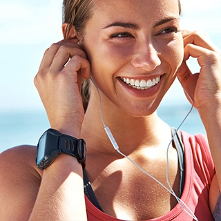 Holmes Place | Woman Headphones Smiling