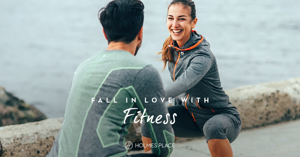 Holmes Place | man and woman working out together