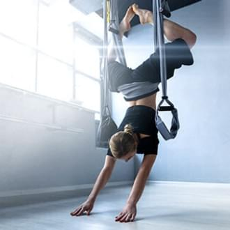 aerial yoga antigravity suspension training group class fitness workout Holmes Place