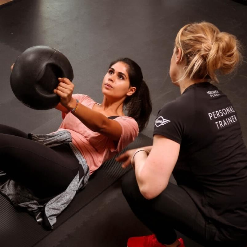Women in while her personal training session.