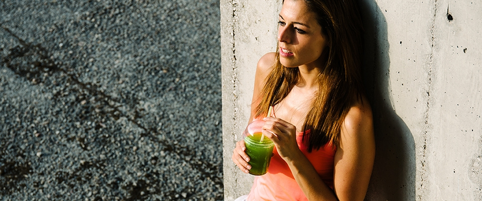 woman drinking green smoothie detox | Holmes Place