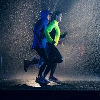 People running in the dark raining