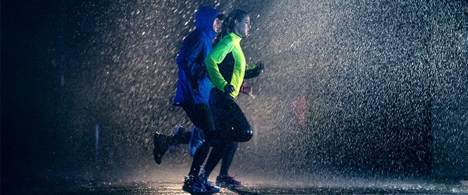 People running in the dark raining