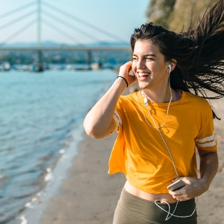 woman river jogging running outdoors playlist soundtrack music Holmes Place