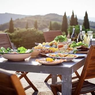 mediterranean diet table set family meal outdoors sunny day Holmes Place