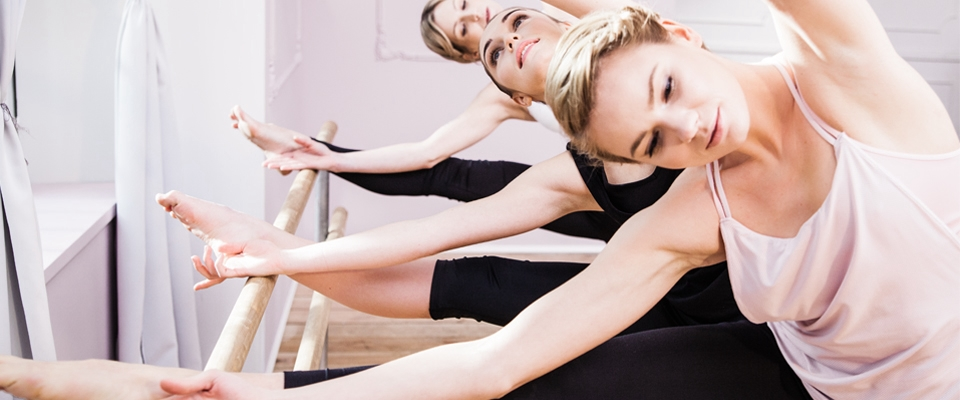 Group class women dancing ballet barre fitness | Holmes Place
