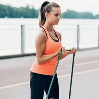woman outdoors lake park fitness jumping rope Holmes Place