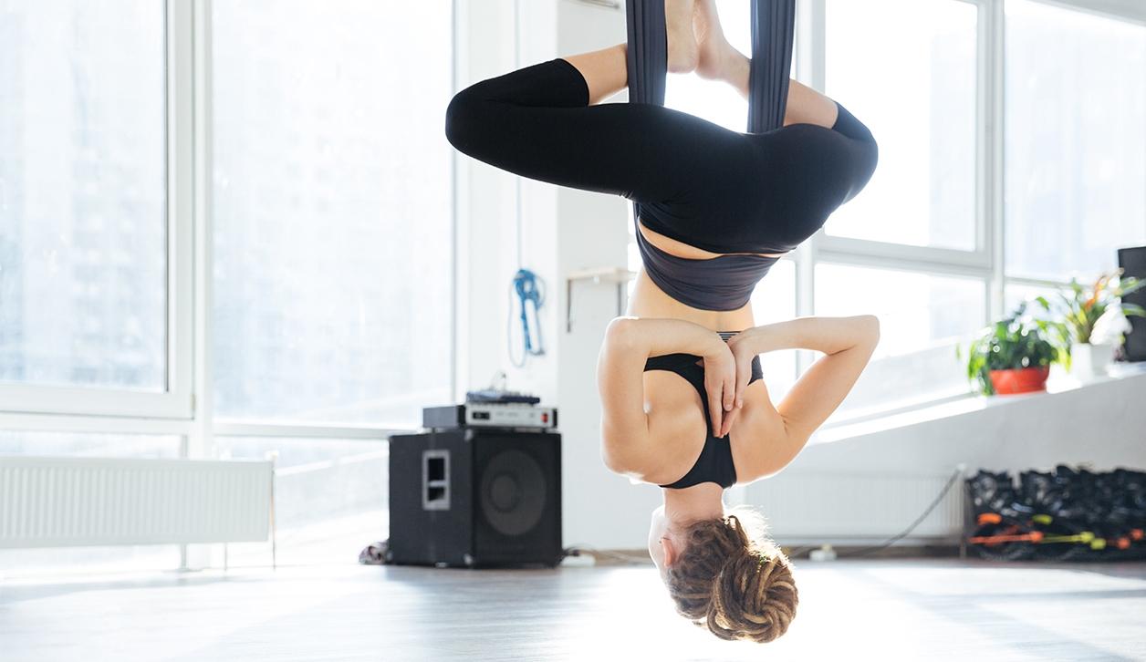 Lady doing Aerial Yoga