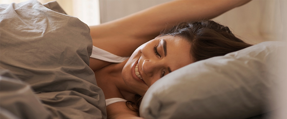 Woman in the bed | Sleep and Health | Holmes Place
