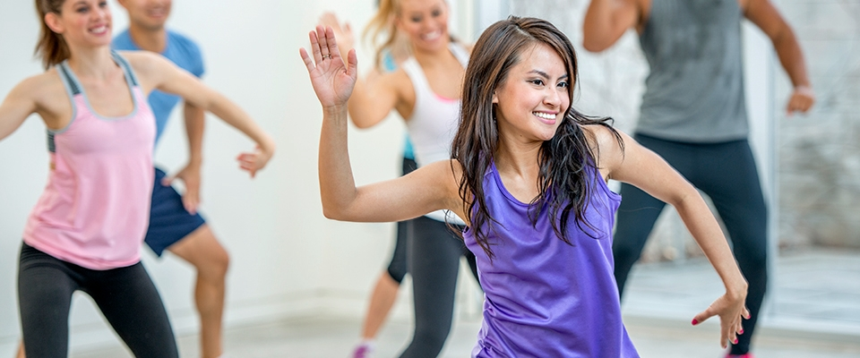 fitness dance class group of women indoors | Holmes Place