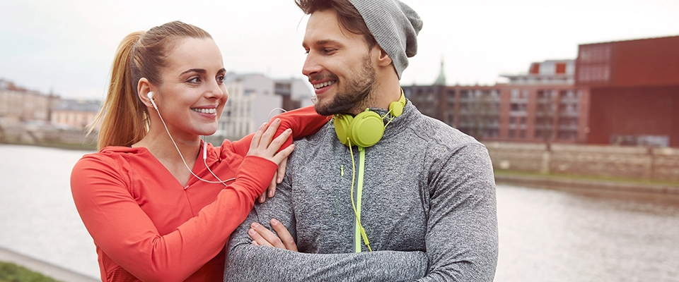 couple workout trining music headphones Holmes Place