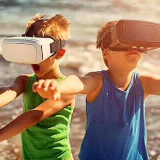 two little kids boys VR sets outdoors | Holmes Place