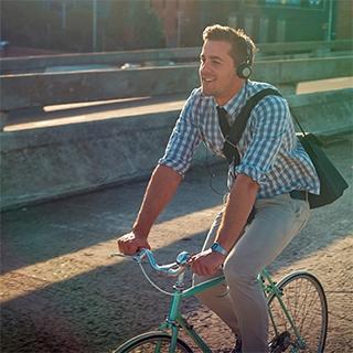 Holmes Place | Man Riding Bike Listening Music