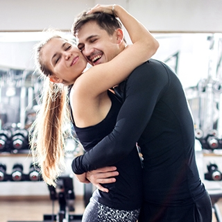 fitness valentine workout fall in love personal trainer Holmes Place hug man woman gym